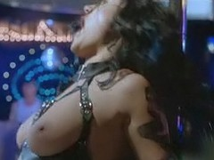 Jennifer Tilly topless in black leather