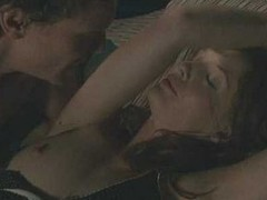 Kelly Reilly in topless scene outside