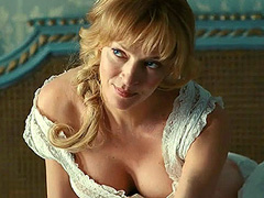Uma Thurman big cleavage in a tight bodice