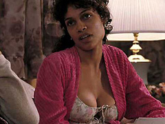 Rosario Dawson busts an awesome cleavage