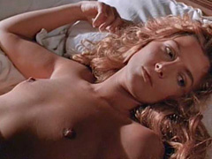 Natasha Richardson lying topless in bed