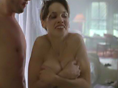 Hilary Swank squeezes her big breasts