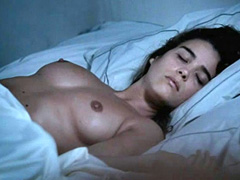 Vahina Giocante topless lying in bed