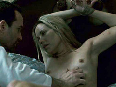 Maria Bello laying down whilet tied up