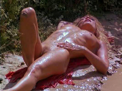 Ellen Barkin totally nude lying by a stream