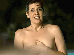 Melanie Lynskey topless in a swimming pool