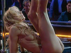 Daryl Hannah dancing topless on stage