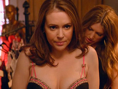 Alyssa Milano cleavy in a very low cut bustier