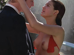Phoebe Cates unhooks top and shows boobs