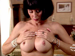 Nikki Fritz topless squeezes her big breasts