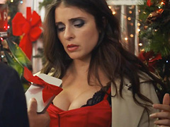 Shiri Appleby busts some red hot cleavage