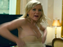 Kirsten Dunst big boob poping out of dress