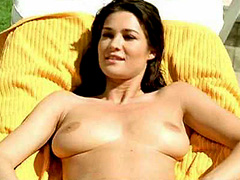 Manuela Arcuri topless sunning big breasts