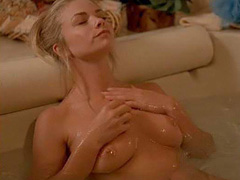 Jaime Pressly sitting nude in bathtub