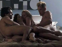 Amber Heard naked in a foursome on a bed