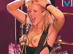 Courtney Love topless playing a quitar