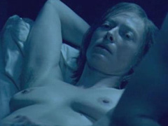 Tilda Swinton topless showing her breasts