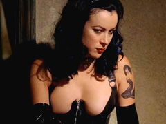 Jennifer Tilly busty in dominatrix outfit