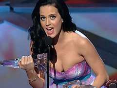 Katy Perry breasts busting out of dress